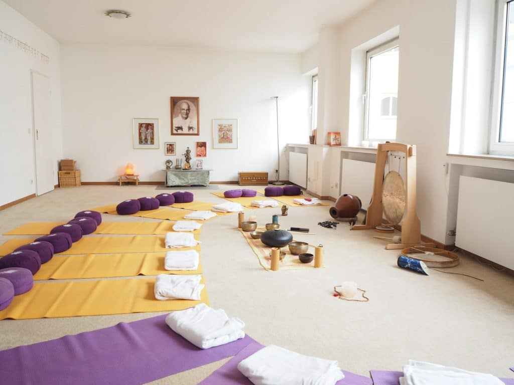 Instrument set up with yoga mats and cushions and blanket for a sound healing therapy healing